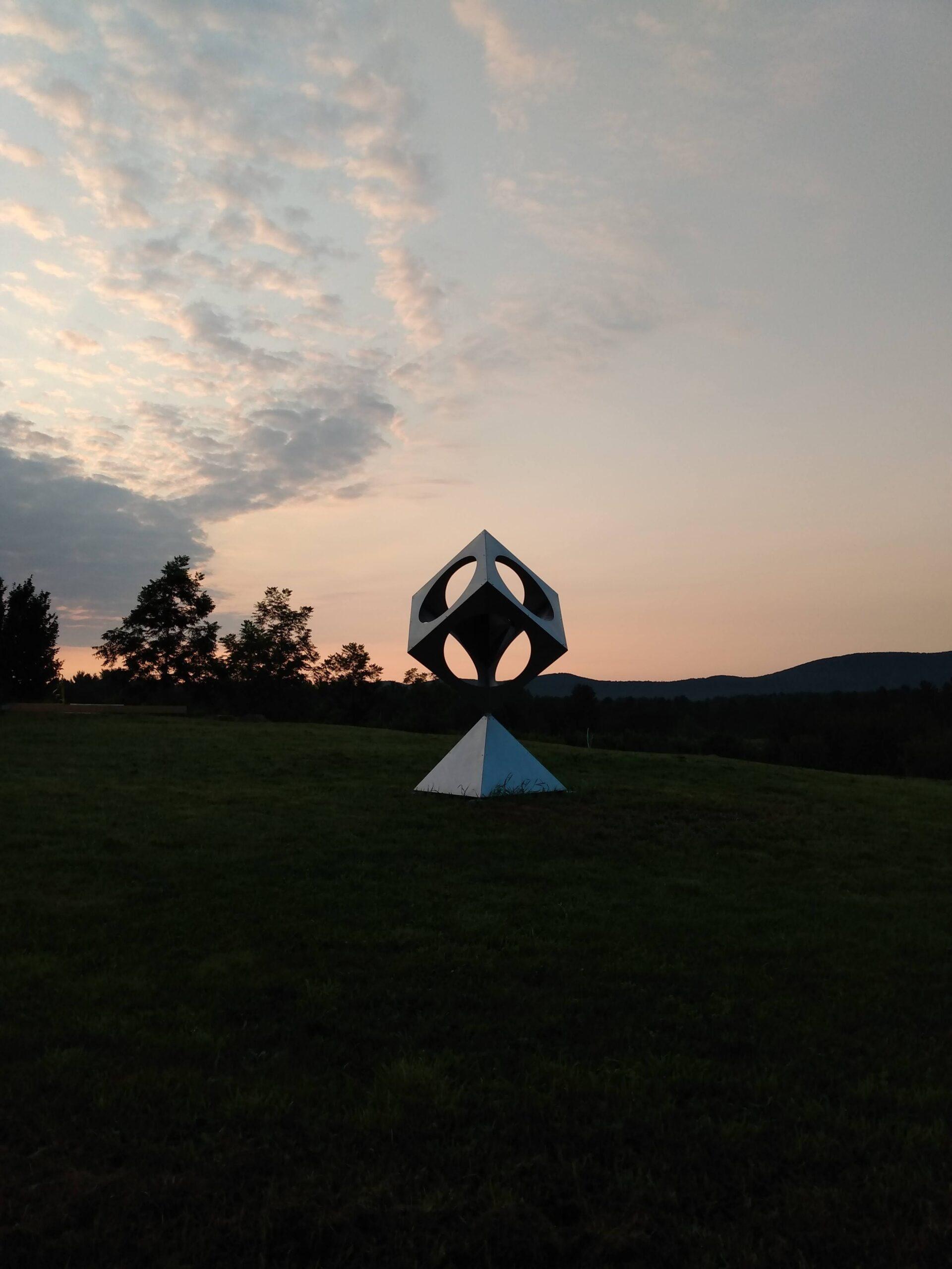 sculpture against sunrise