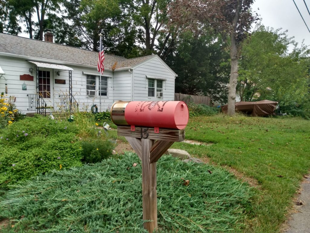 Mailbox in the shape of a rifle cartridge
