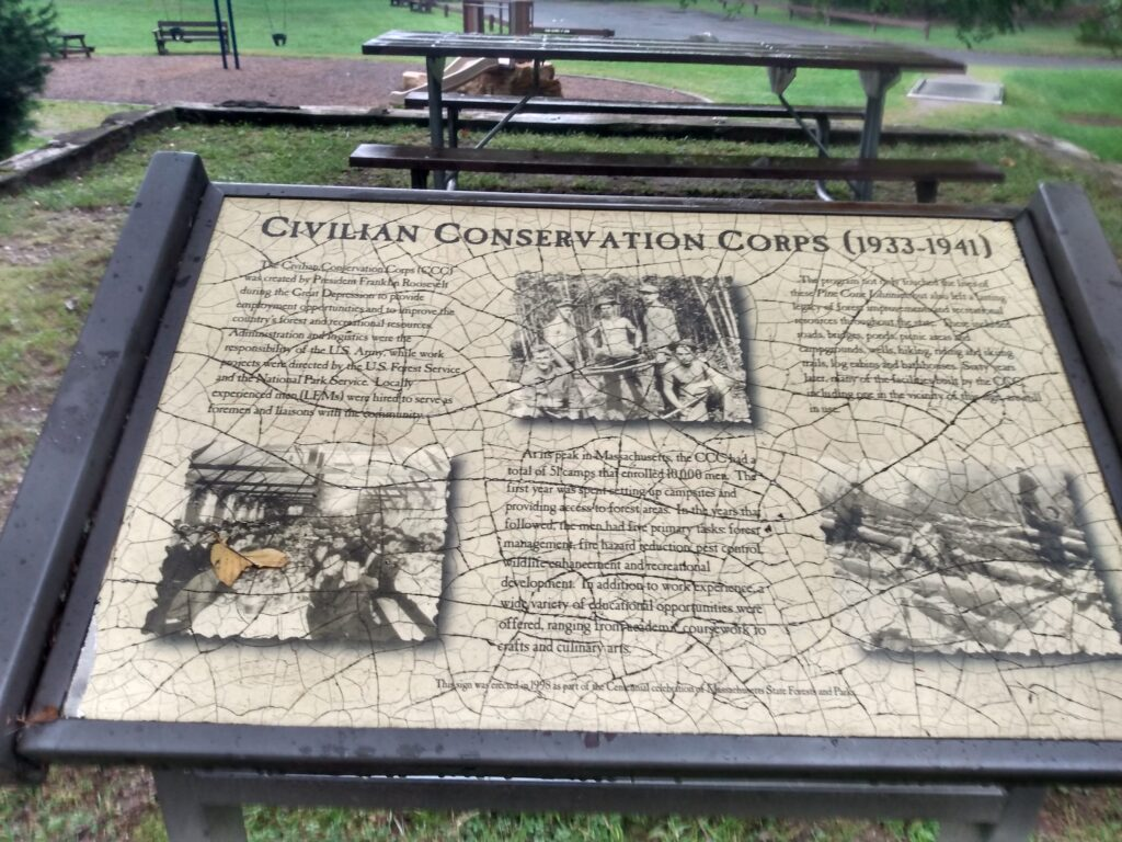 Cracked informational sign about the Civilian Conservation Corps