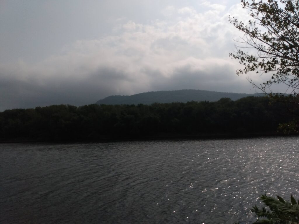 River view with clouds over a mountain range